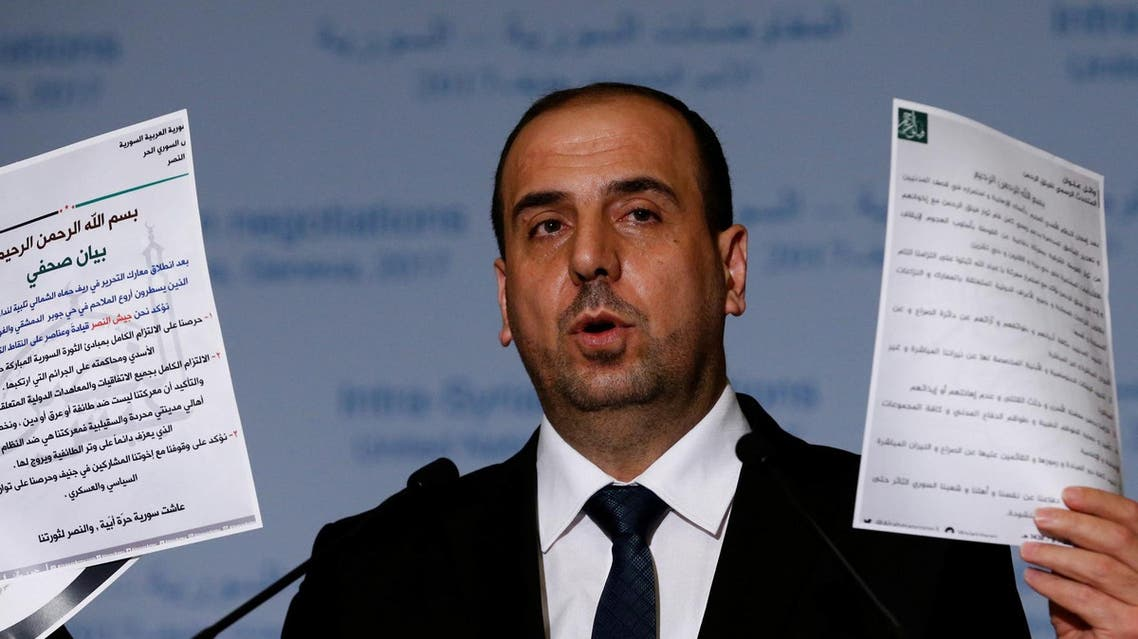 Nasr al-Hariri Head of the Syrian High Negotiations Committee (HNC) opposition group holds documents during a news conference after a meeting during the Intra Syria talks at the European headquarters of the United Nations in Geneva, Switzerland March 24, 2017. (Reuters)