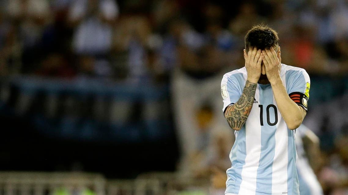 Argentina's Lionel Messi reacts after missing a chance to score during a 2018 Russia World Cup qualifying soccer match between Argentina and Chile at the Monumental stadium in Buenos Aires, Argentina, Thursday March 23, 2017. At left is Argentina's Lionel Messi. (AP)
