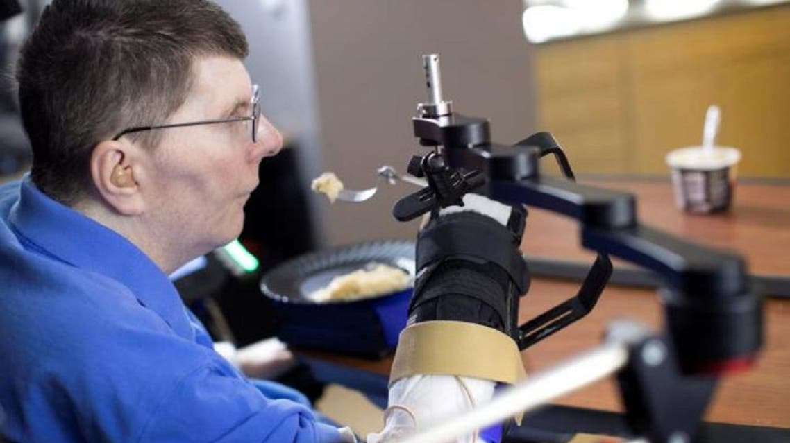 Bill Kochevar, 56, is using computer-brain interface technology and an electrical stimulation system to move his own arm after eight years of paralysis, in this undated handout photo. (Reuters)