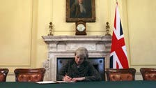 British PM Theresa May signs Brexit letter invoking Article 50