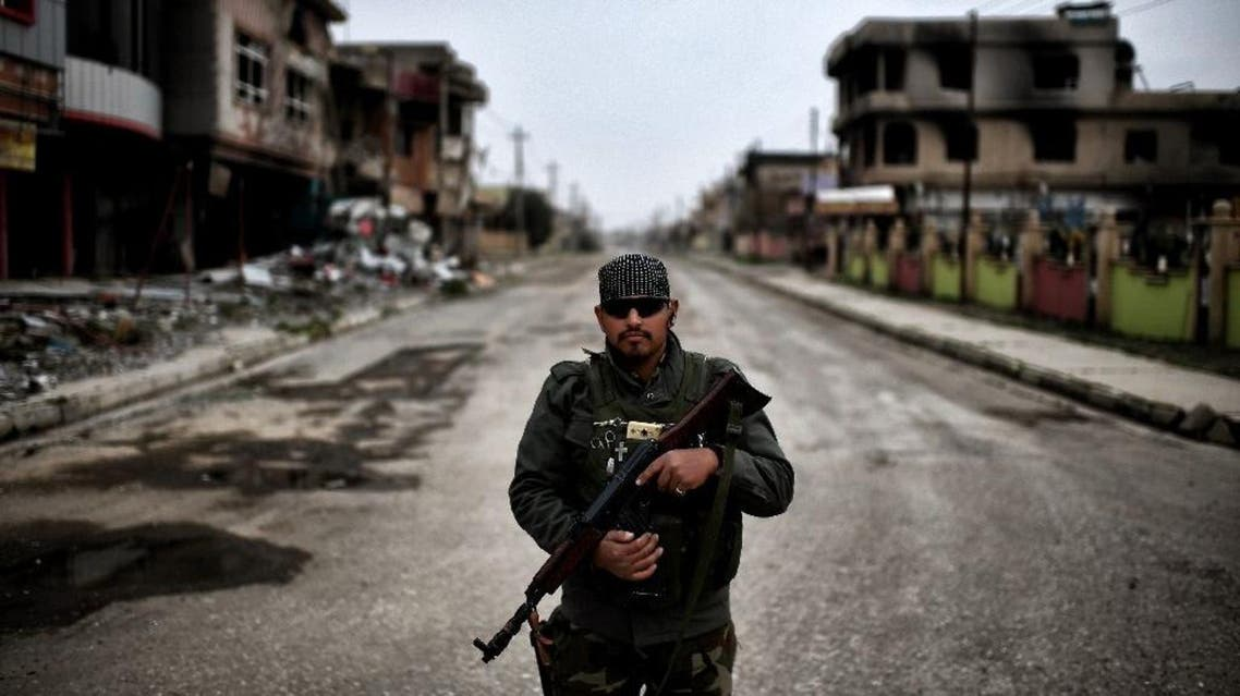 Qaraqosh was ravaged by ISIS, who seized it in June 2014 as they rampaged across parts of northern Iraq. Although the group has been expelled from Qaraqosh in October 2016, life has not returned to its once-vibrant and wealthy neighbohoods. (AFP)