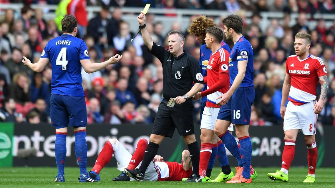 """Britain Soccer Football - Middlesbrough v Manchester United - Premier League - The Riverside Stadium - 19/3/17 Manchester United's Phil Jones is shown a yellow card by referee Jon Moss Reuters / Anthony Devlin Livepic EDITORIAL USE ONLY. No use with unauthorized audio, video, data, fixture lists, club/league logos or """"live"""" services. Online in-match use limited to 45 images, no video emulation. No use in betting, games or single club/league/player publications. Please contact your account representative for further details."""
