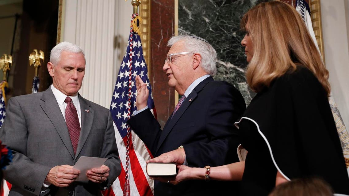 Vice President Mike Pence, left, administers the oath of office to US Ambassador to Israel David M. Friedman, center, accompanied by his wife Tammy, right, in Washington. (AP)
