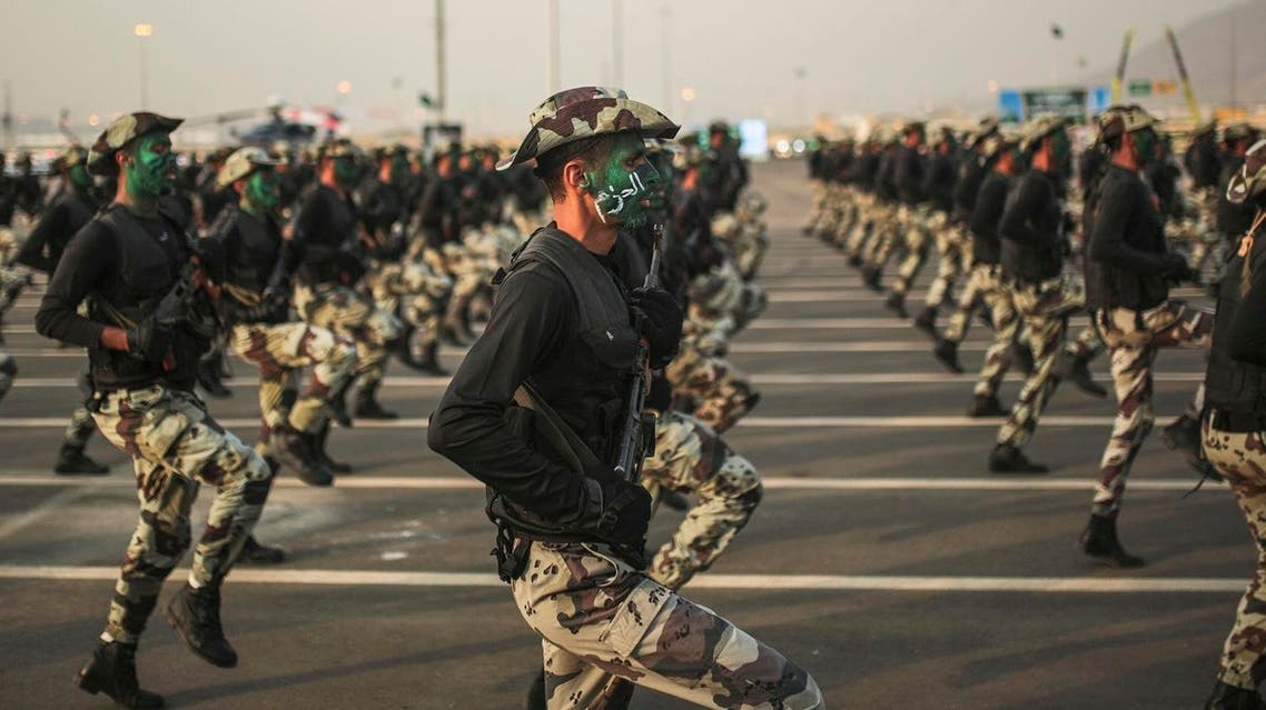 In this Thursday, Sept. 17, 2015 file photo, Saudi security forces, whose faces display the word 'Decisive' take part in a military parade. (File photo: AP)