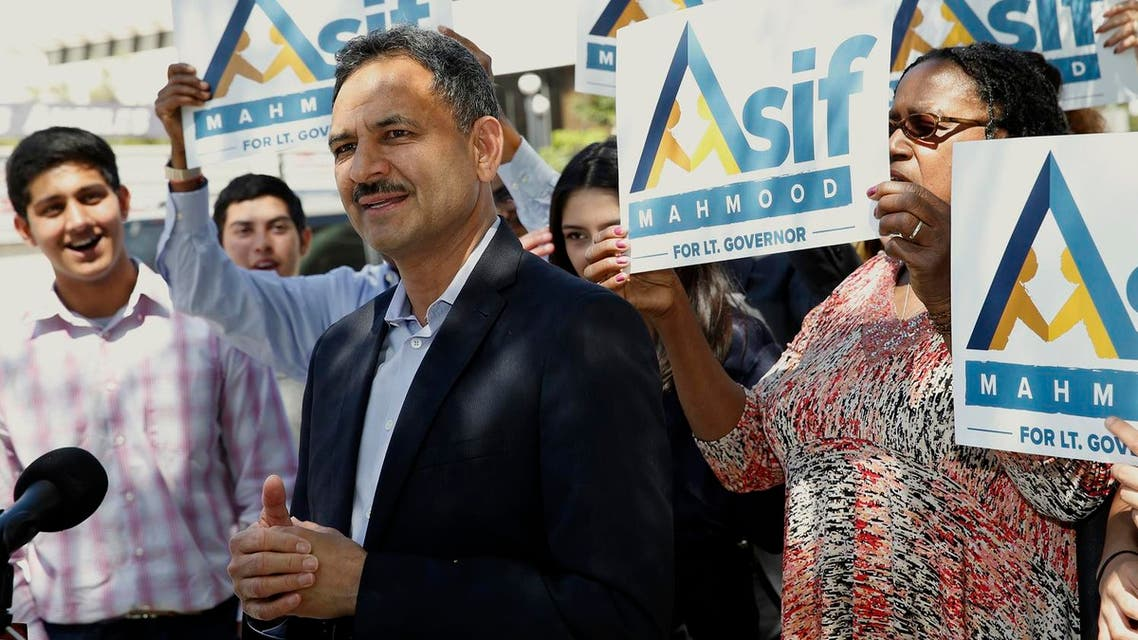 Dr. Asif Mahmood announces he is joining the race in front of the federal building that houses a US Immigration and Customs Enforcement field office in Los Angeles on March 29, 2017. (AP)