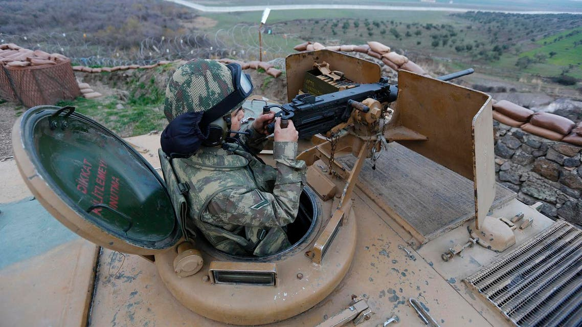 A Turkish soldier on an armoured military vehicle surveys the border line between Turkey and Syria, near the southeastern city of Kilis, Turkey, March 2, 2017. REUTERS/