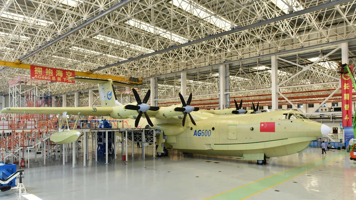 In this Saturday, July 23, 2016 photo released by Xinhua News Agency, the Amphibious aircraft AG600 rolls off a production line in Zhuhai, south China's Guangdong Province. The Xinhua News Agency China said China unveiled the world's largest amphibious aircraft that Beijing plans to use for marine missions and fighting forest fires on Saturday. It measures 37 meters (121 feet) in length with a wingspan of 39 meters (128 feet).