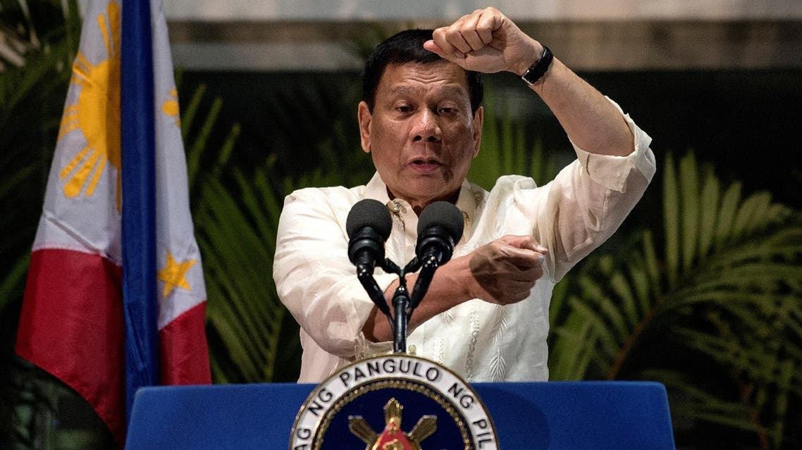 This picture taken on March 23, 2017 shows Philippine President Rodrigo Duterte speaking to the media at Manila International Airport upon his return from Thailand and Myanmar. Three turbulent decades after the Philippines shed dictatorship, President Rodrigo Duterte is offering a return to authoritarian rule as a solution to all the problems democracy has failed to fix. AFP