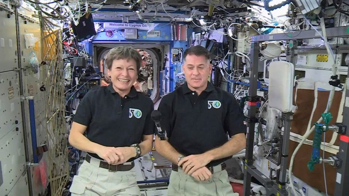 In this image made from video provided by NASA, U.S. astronauts Peggy Whitson, left, and Shane Kimbrough speak from the International Space Station during an interview on Tuesday, Jan. 3, 2017. (AP)