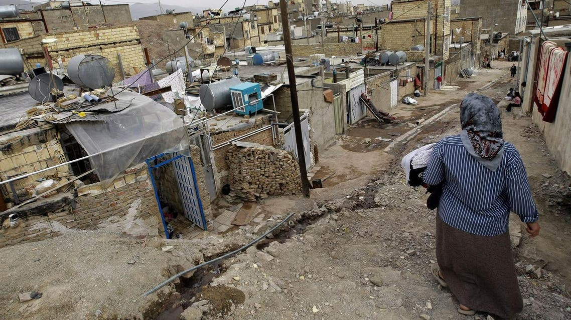 An Iranian woman walks in a poor neighbourhood in the town of Ghaleh Hassan Khan on the southwestern outskirts of Tehran on March 11, 2008. (AFP)