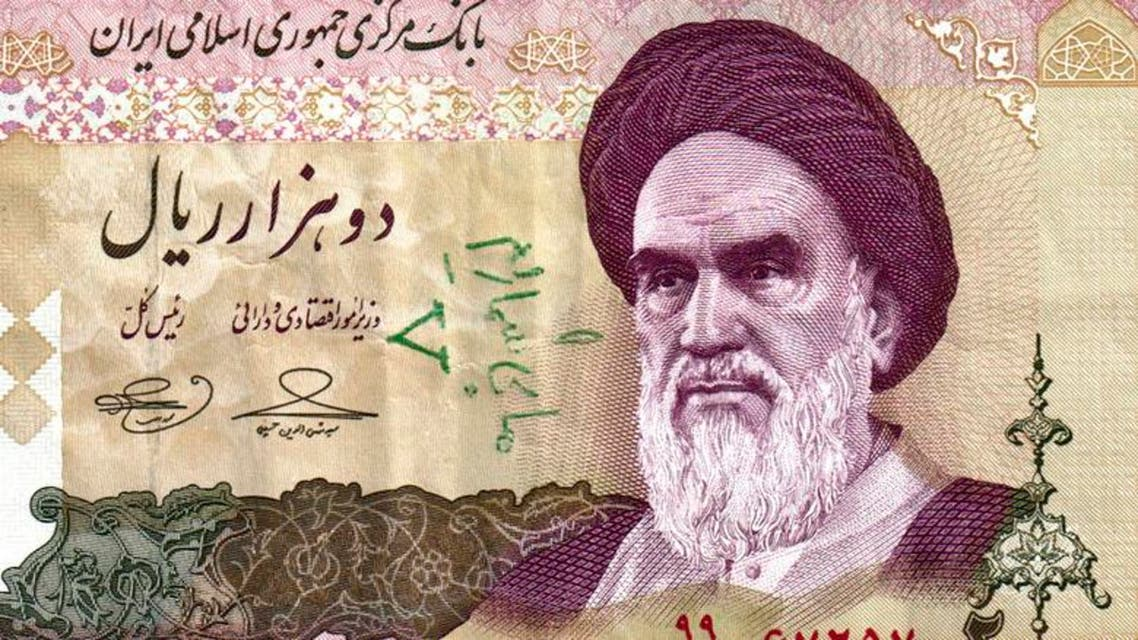 A 2,000 rial Iranian banknote showing Ayatollah Ruhollah Khomeini and a handwritten pro-opposition graffiti in Farsi. (File photo: AP)