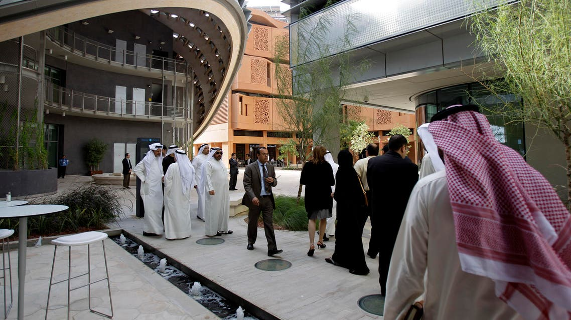 In this Jan. 16, 2011 file photo, people visit the Masdar Institute campus, part of Masdar City, a Mubadala company, in Abu Dhabi. (AP)