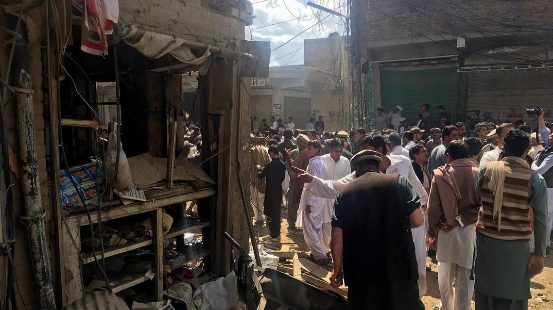 Residents gather near a damaged shop in a market after a blast in Parachinar, Pakistan,  March 31, 2017. (Reuters)