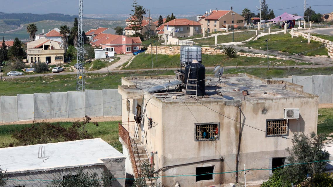 A picture taken on March 25, 2017 from the West Bank town of Ramadin, southwest of Hebron, shows the Israeli settlement of Eshkolot and it's surrounding defensive wall.