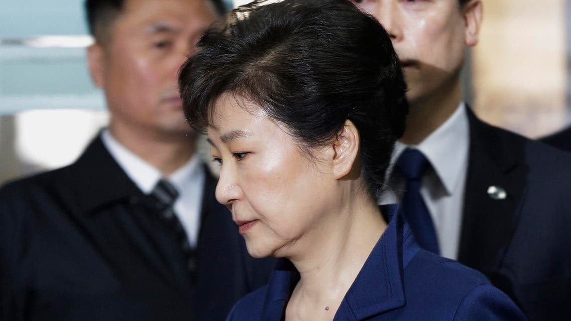 Ousted South Korean President Park Geun-hye arrives for questioning on her arrest warrant at the Seoul Central District Court in Seoul, South Korea, Thursday, March 30, 2017.
