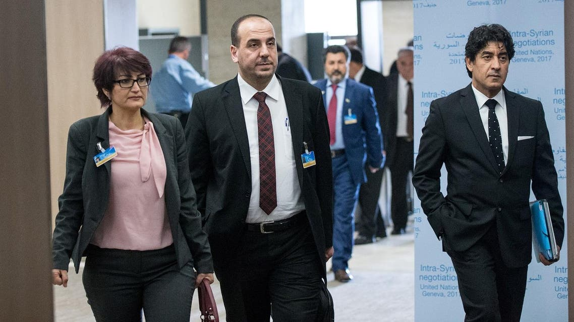 Syria's opposition delegation leader Nasr al-Hariri (C) arrives for a meeting of Intra-Syria peace talks with UN Special Envoy for Syria Staffan de Mistura at Palais des Nations in Geneva, Switzerland, March 25, 2017. REUTERS/Xu Jinquan/Pool