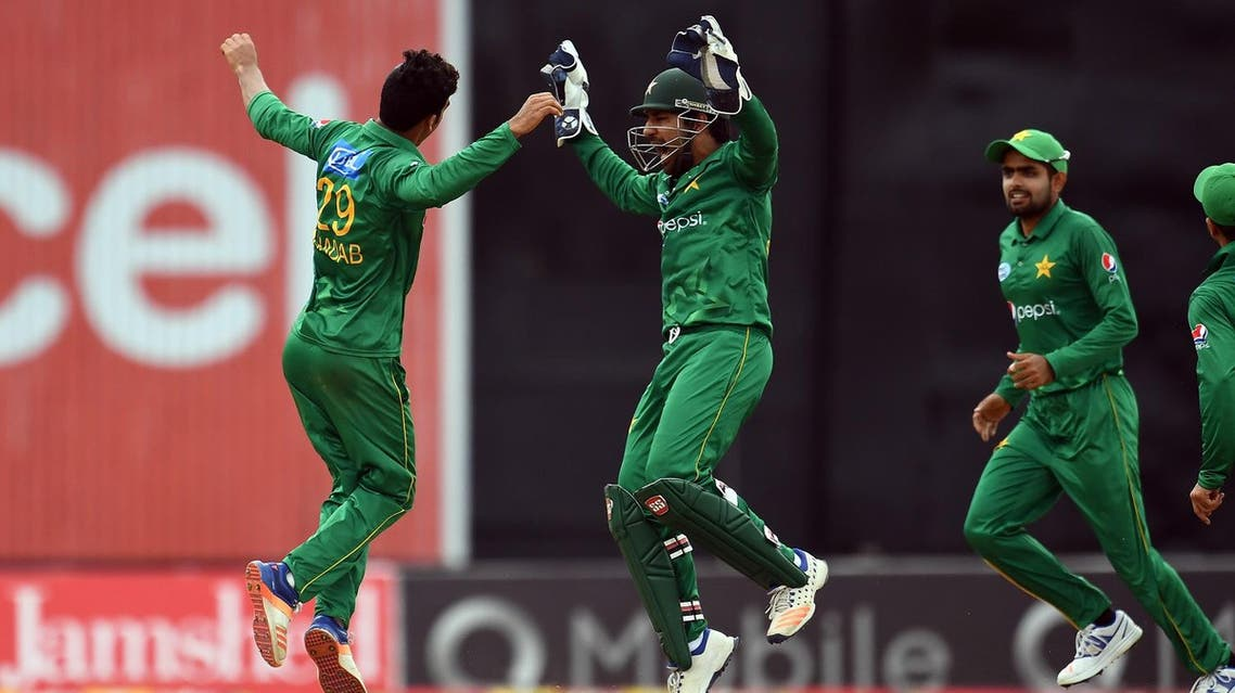 Pakistan's Shadab Khan celebrates with team captain/wicketkeeper Sarfraz Ahmed after bowling out West Indies' Rovman Powell (R) during the second T20I match against West Indies at the Queen's Park Oval in Port of Spain, Trinidad, on March 30, 2017. (AFP)