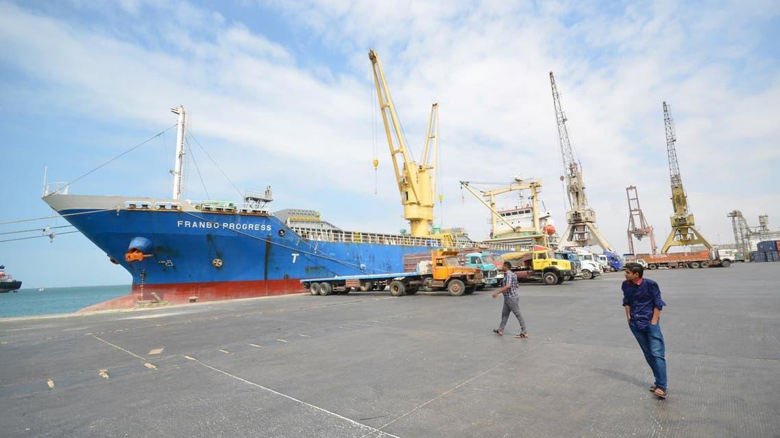 People walk past a ship ducked at the Red Sea port of Hodeidah, Yemen February 1, 2017. REUTERS/Abduljabbar Zeyad