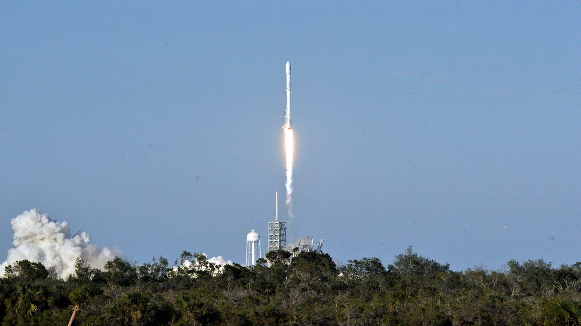 SpaceX's Falcon 9 rocket lifts off from space launch complex 39A at Kennedy Space Center, Florida on March 30, 2017, with an SES communications satellite. SpaceX blasted off a recycled rocket for the first time on, using a booster that had previously flown cargo to the astronauts living at the International Space Station.