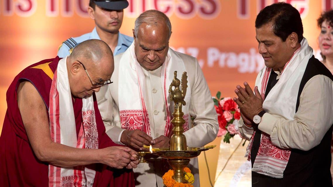 Tibetan spiritual leader the Dalai Lama lights the lamp, as Assam chief minister Sarbananda Sonowal, right, and Governor of Assam Banowari Lal Purohit watch him at the platinum jubilee celebrations of Assam Tribune newspaper in Gauhati, India, on Saturday, April 1, 2017. (AP)