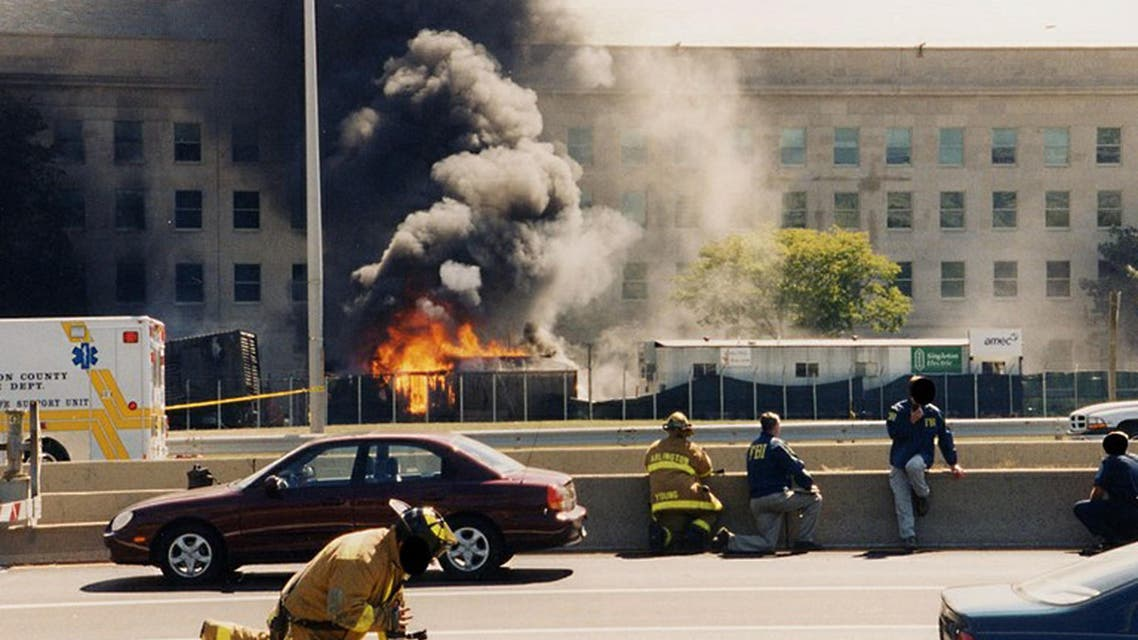 This image by the Federal Bureau of Investigation (FBI) newly released on March 31, 2017, shows first responders at the Pentagon after American Airlines Flight 77 crashed into the Pentagon on September 11, 2001.