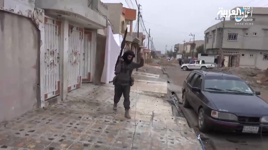 Screengrab from an ISIS propaganda video shows one of their militants holding a rocket launcher during clashes in Mosul. (Amaq News Agency)