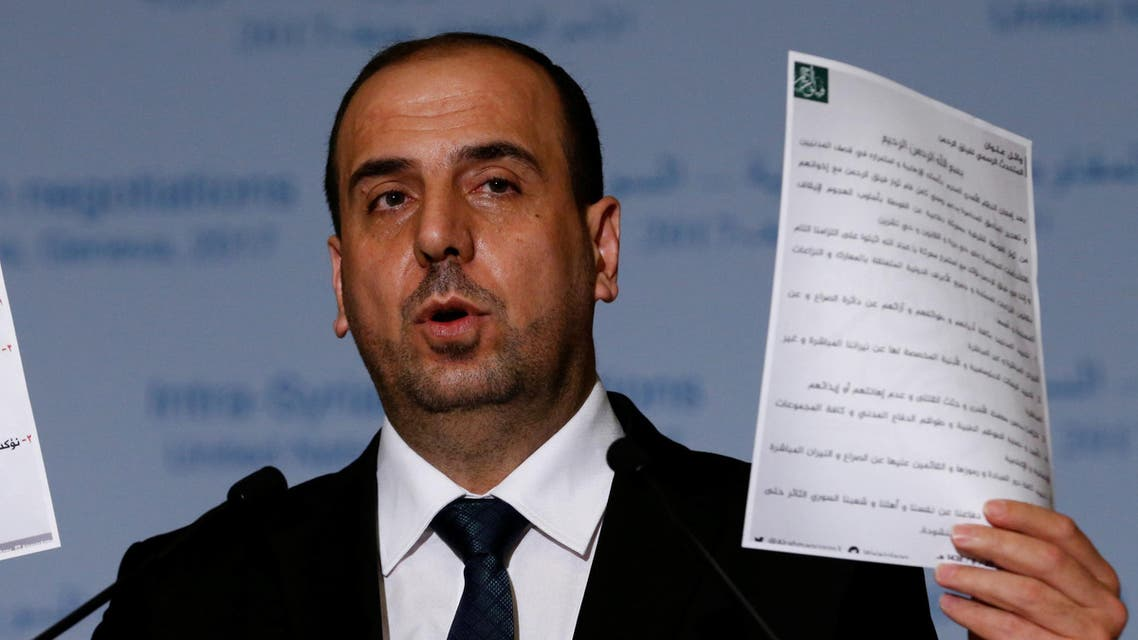 Nasr al-Hariri Head of the Syrian High Negotiations Committee (HNC) opposition group holds documents during a news conference after a meeting during the Intra Syria talks at the European headquarters of the United Nations in Geneva, Switzerland March 24, 2017. REUTERS/Denis Balibouse