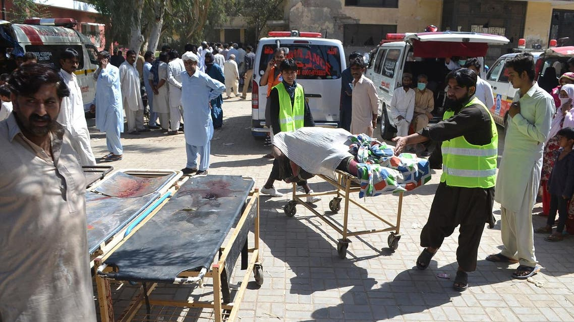Pakistani volunteers transport the body of a victim murdered at a Sufi shrine by three suspects including the shrine's custodian on the outskirts of Sargodha District in Punjab province on April 2, 2017. (AFP)