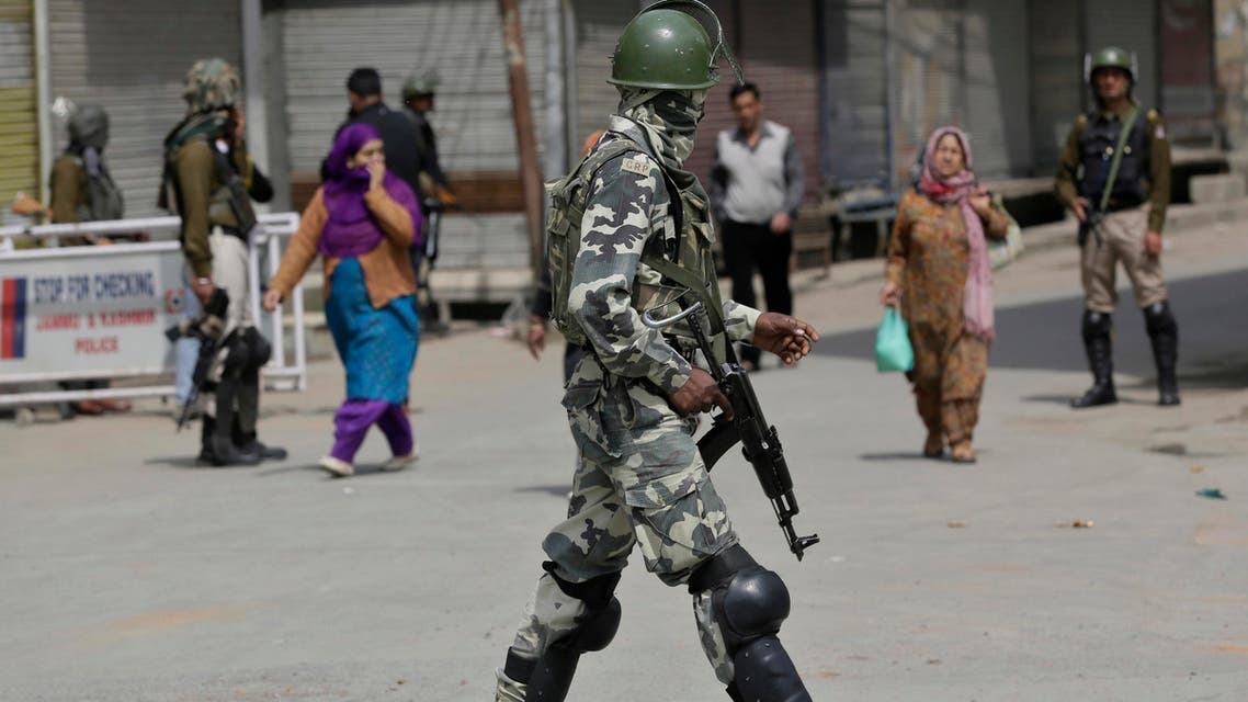An Indian paramilitary soldier patrols at a closed market during a strike in Srinagar, Indian controlled Kashmir, Sunday, April 2, 2017. (AP)