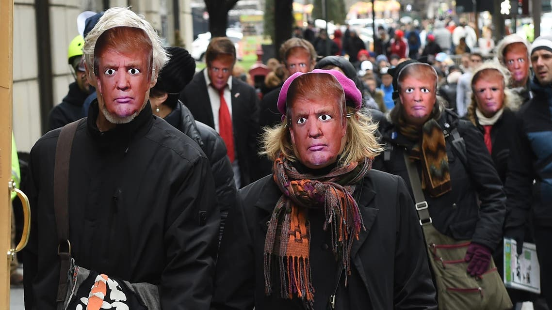 People wearing masks of US President Donald Trump take part in the 32nd Annual April Fools' Day Parade in New York on April 1, 2017.