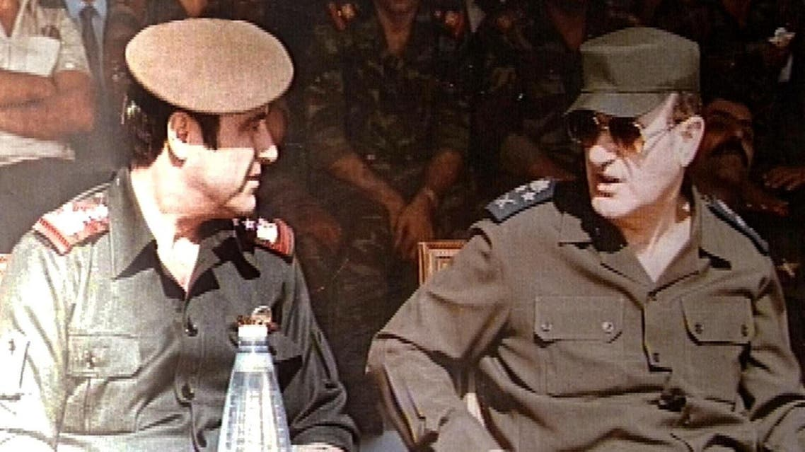 Picture taken in 1984 shows the late Syrian president Hafez al-Assad (R) with his youngest brother Rifaat (L) at a military ceremony in Damascus. AFP