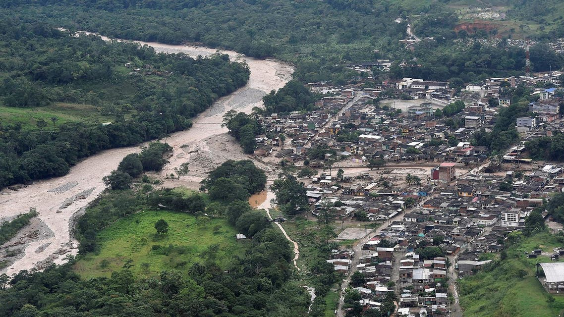 An aerial view shows a flooded area after heavy rains caused several rivers to overflow, pushing sediment and rocks into buildings and roads in Mocoa, Colombia April 1, 2017. (Reuters)