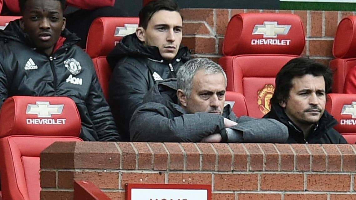Manchester United's Portuguese manager Jose Mourinho (C) watches from the dugout seated next to Manchester United's Portuguese assistant manager Rui Faria (R) during the English Premier League football match between Manchester United and West Bromwich Albion at Old Trafford in Manchester, north west England, on April 1, 2017.  (AFP)