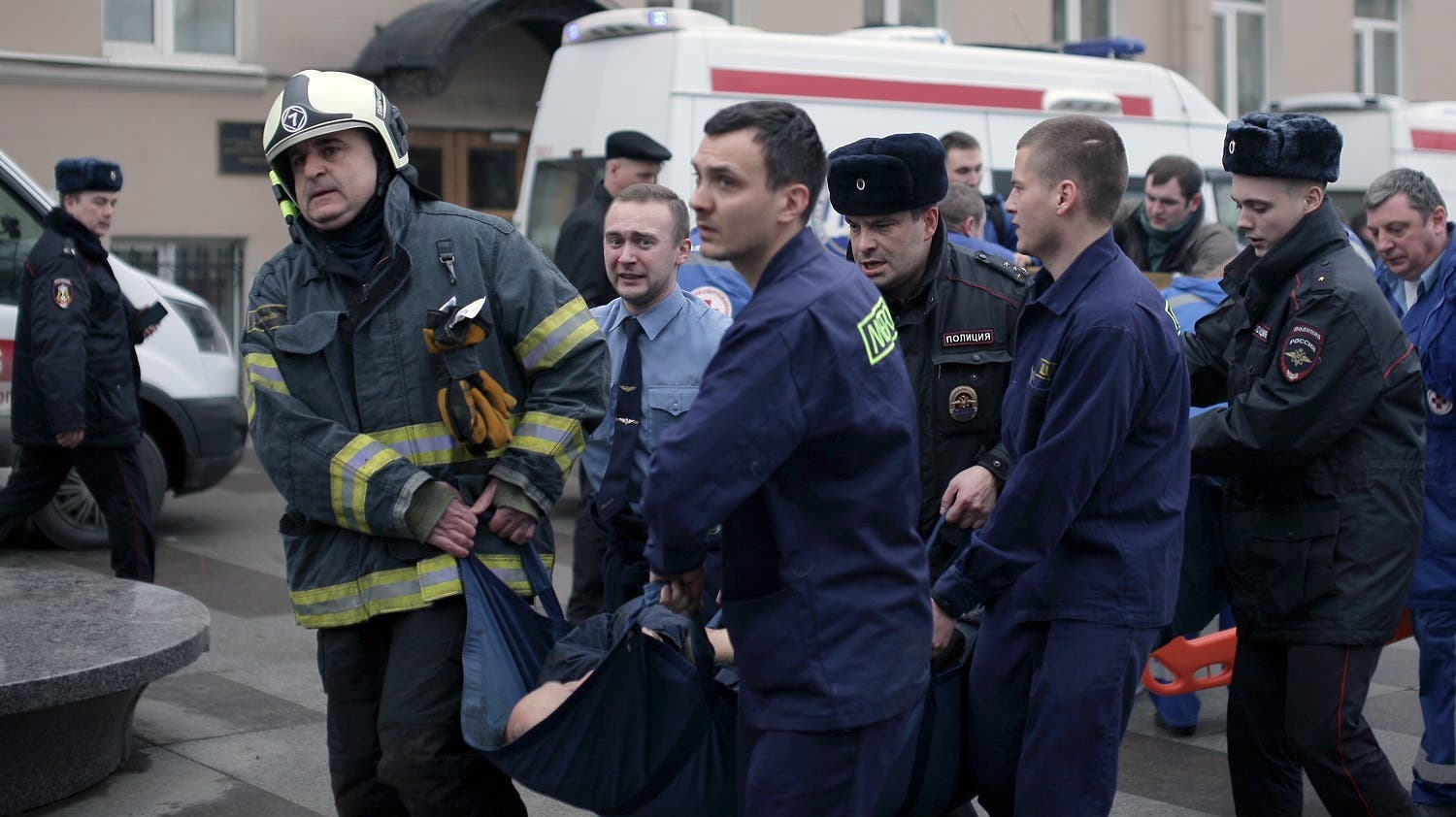 Police and emergency services personnel carry an injured person on a stretcher outside Technological Institute metro station in Saint Petersburg on April 3, 2017 (Photo: Alexander Bulekov/AFP)