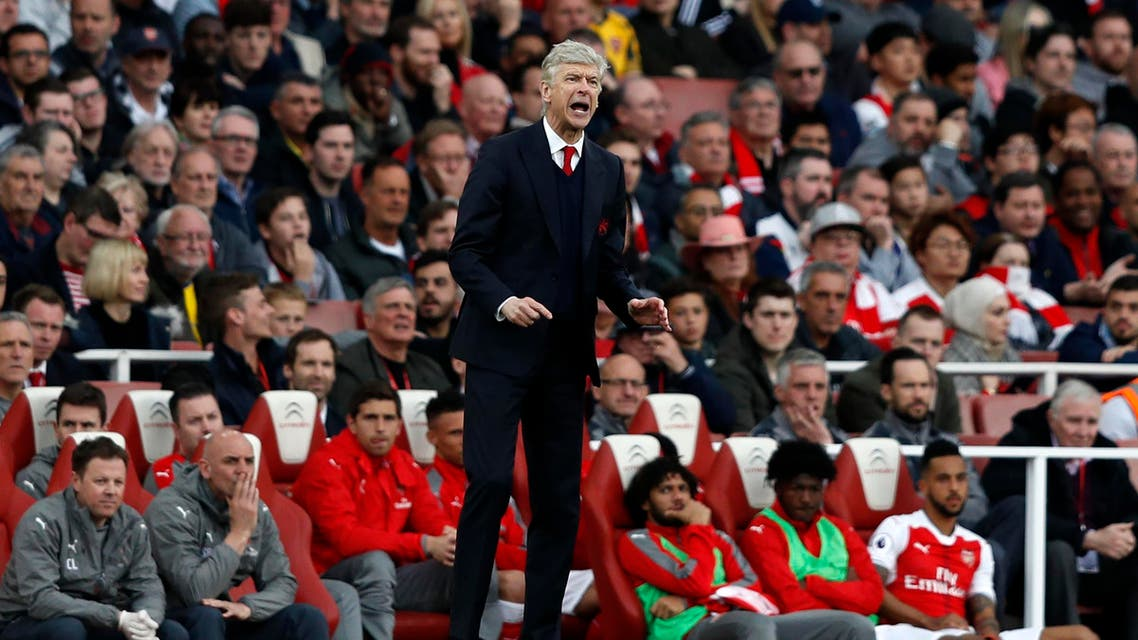Arsenal's French manager Arsene Wenger (C) gestures on the touchline during the English Premier League football match between Arsenal and Manchester City at the Emirates Stadium in London on April 2, 2017. AFP