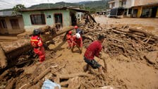 Families in flood-hit Colombian city search for children as death toll rises