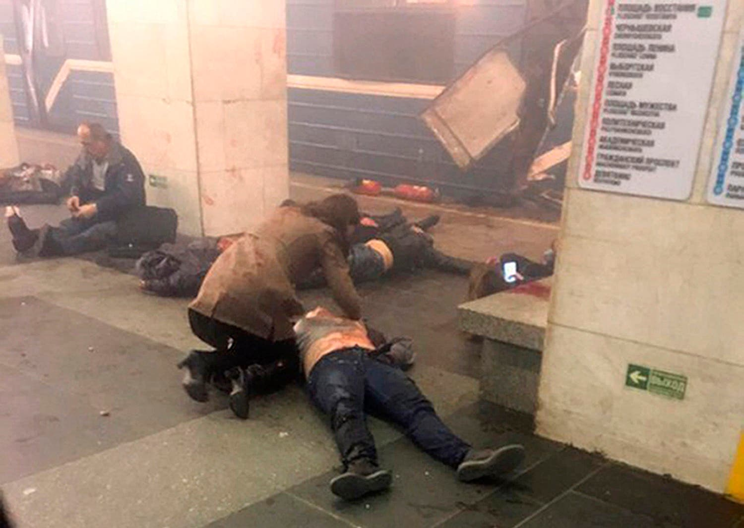 In this image taken from video footage filmed from a moving train on the opposite platform to where the blast occurred, people injured in blast at St. Petersburg's Technological Institute metro station lay on ground, Russia, Monday, April 3, 2017 (Photo: @DARIIIIIINA via AP)