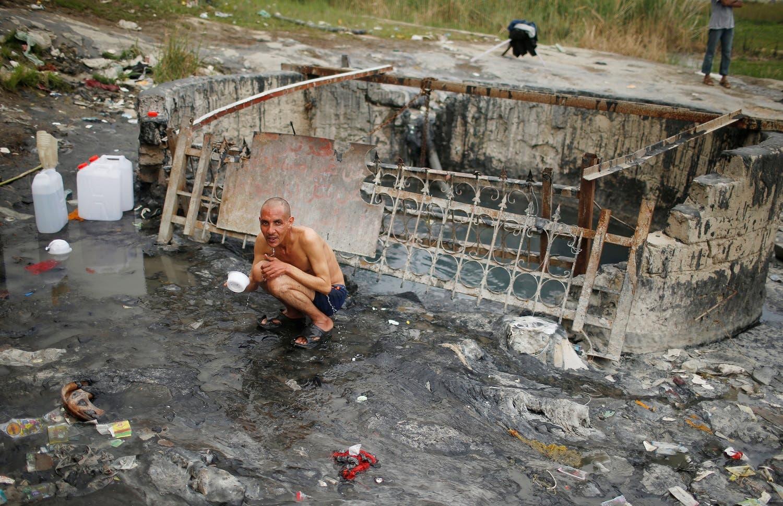An Iraqi man bathes at a sulfur pond at Hammam al-Alil city south of Mosul, Iraq April 3, 2017. Picture taken April 3, 2017 (Photo: Reuters/Suhaib Salem)