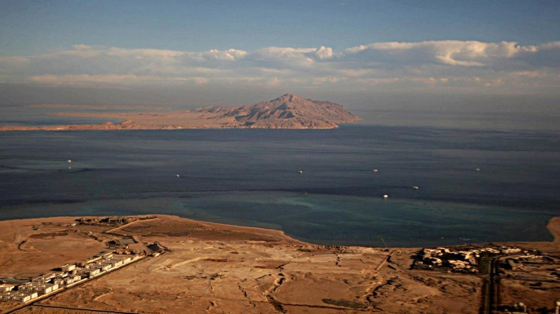 A picture taken on January 14, 2014 through the window of an airplane shows the Red Sea's Tiran (foreground) and the Sanafir (background) islands. (AFP)