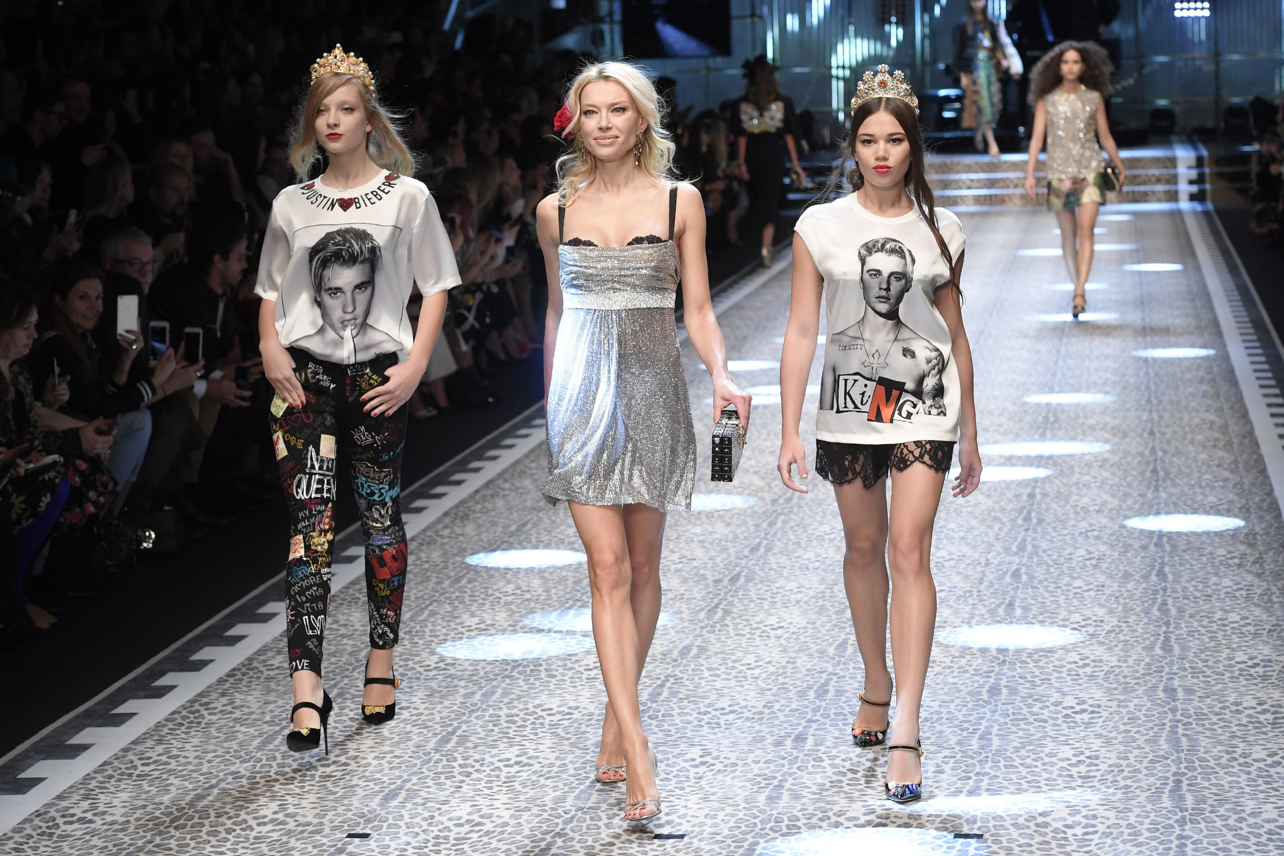 Models present creations for fashion house Dolce & Gabbana during the Women's Fall/Winter 2017/2018 fashion week in Milan, on February 26, 2017. (AFP)