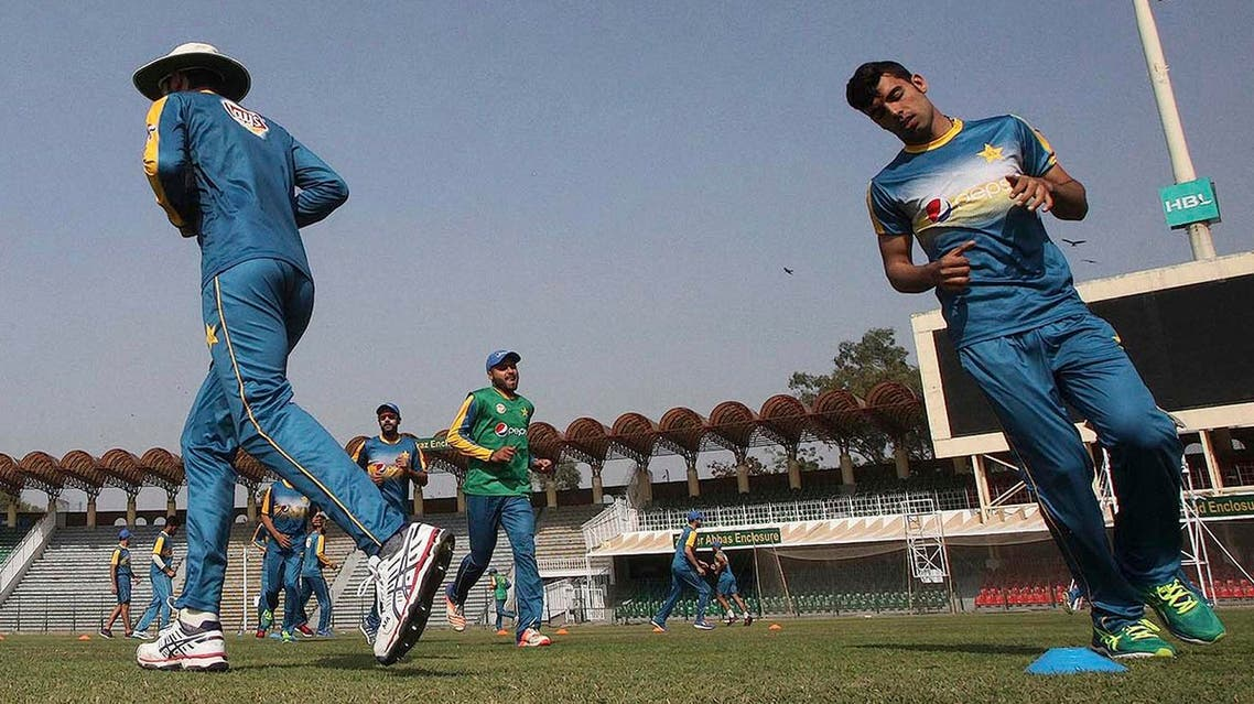 In this March 16, 2017 photo, Pakistan leg-spinner Shadab Khan, right, jogs during a training camp of the national team, at the Gaddafi Stadium in Lahore, Pakistan (File Photo: AP/K.M. Chaudary)