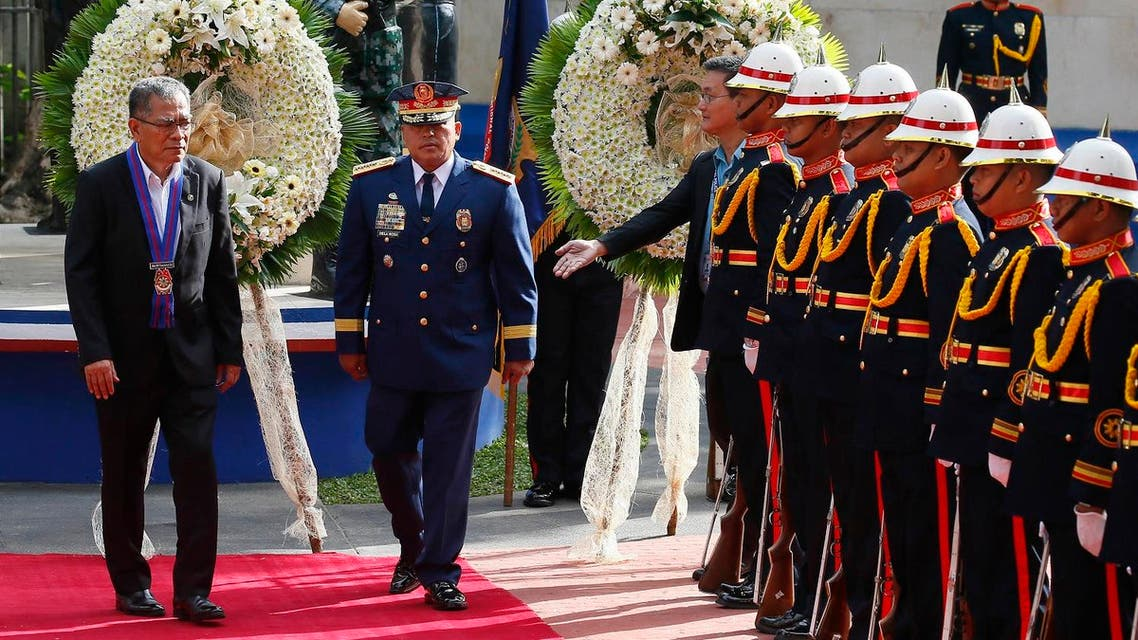 """Secretary Ismael Sueno, left, of the Department of Interior and Local Government at an event with Philippine National Police Chief Director General Ronald """"Bato"""" Dela Rosa (File Photo: AP /Bullit Marquez)"""