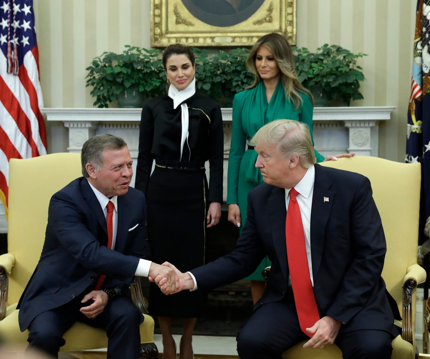 President Donald Trump, accompanied by first lady Melania Trump and Queen Rania, shakes hands with Jordan's King Abdullah II in the Oval Office of the White House in Washington, Wednesday, April, 5, 2017. (AP)