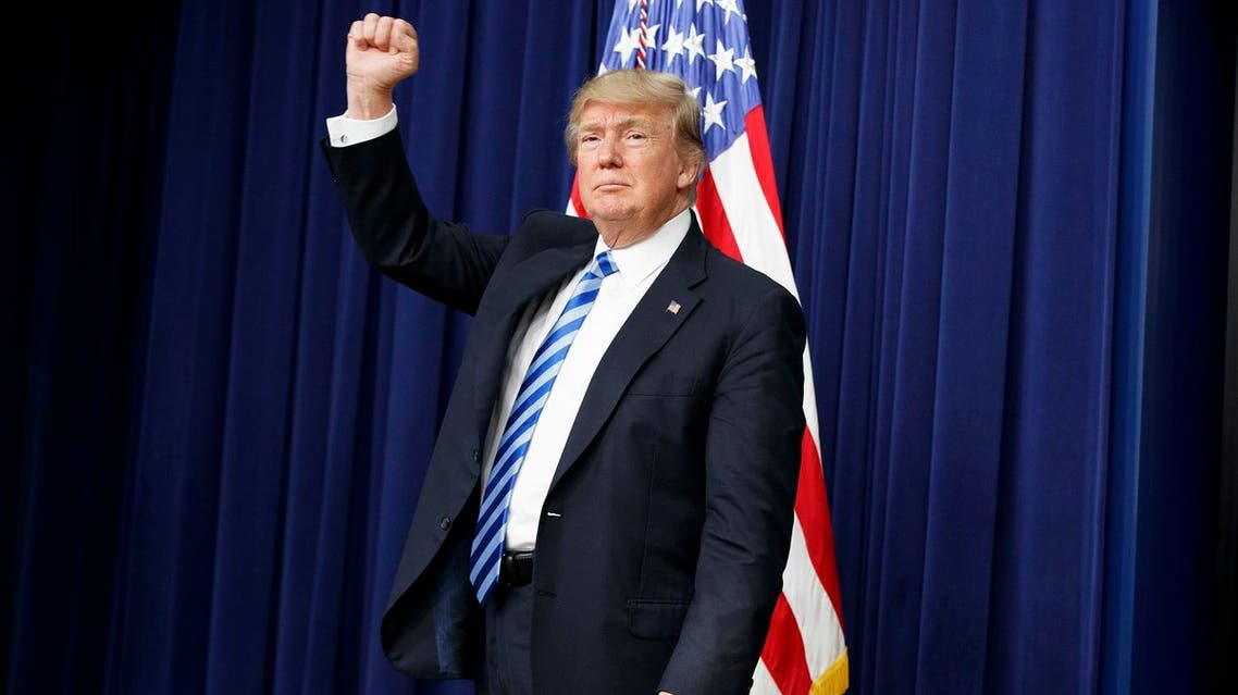 President Donald Trump pumps his fist during a town hall with business leaders in the South Court Auditorium on the White House complex in Washington, Tuesday, April 4, 2017. (AP)