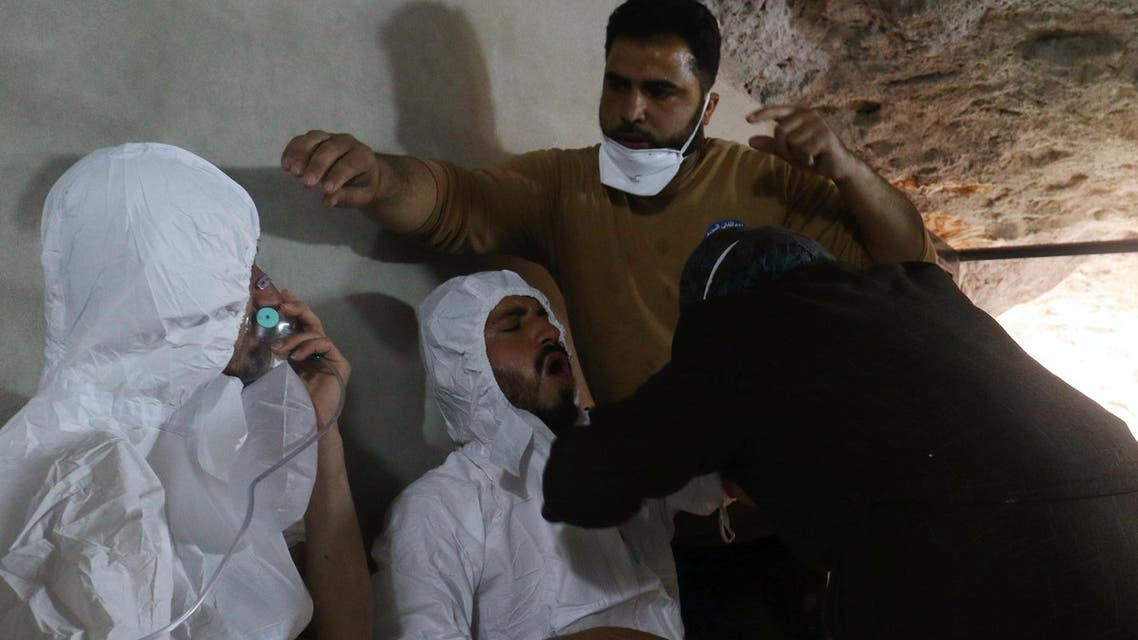 A man breathes through an oxygen mask as another one receives treatments, after what rescue workers described as a suspected gas attack in the town of Khan Sheikhoun in rebel-held Idlib, Syria April 4, 2017
