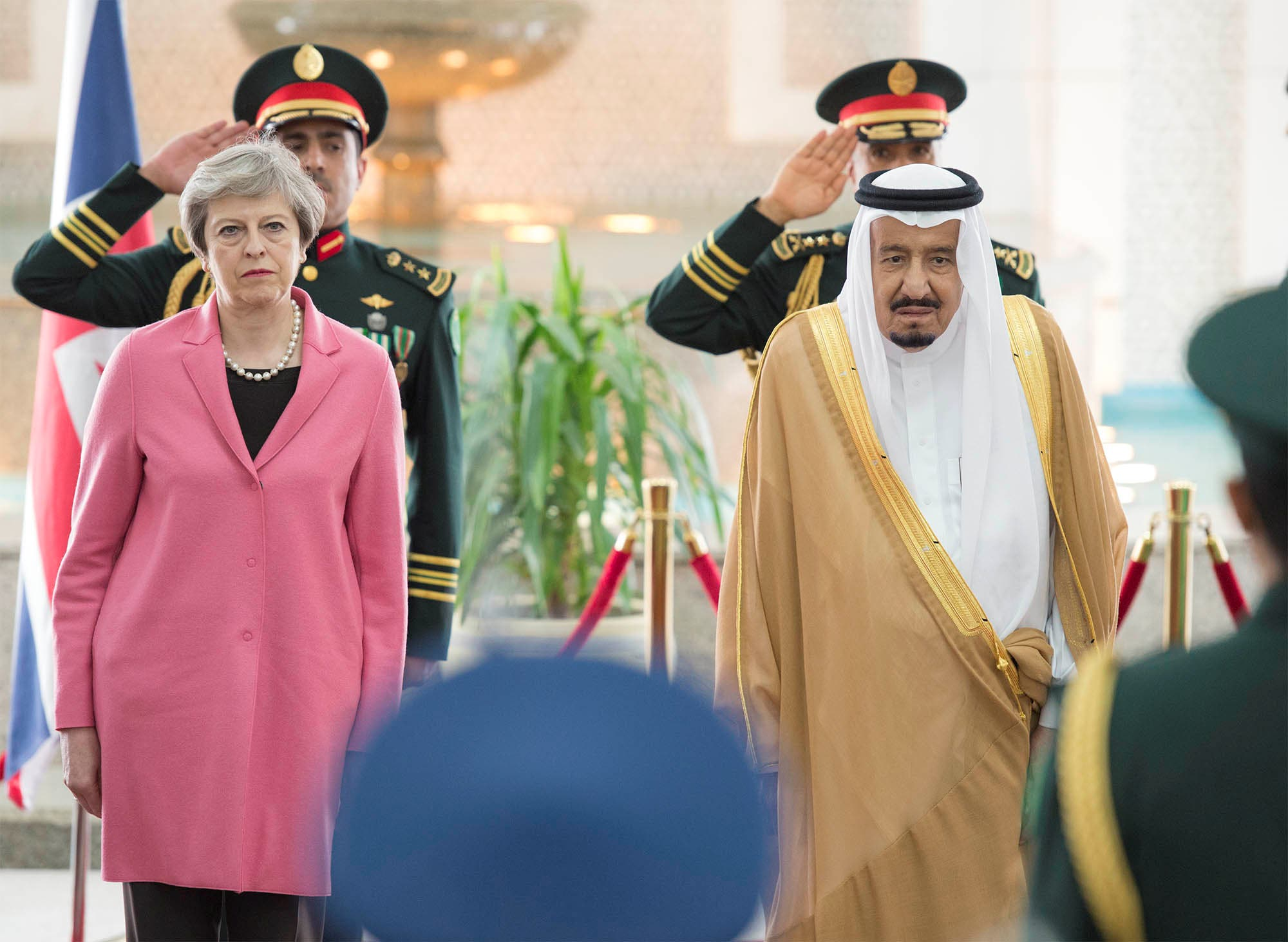 Saudi Arabia's King Salman bin Abdulaziz Al Saud stands next to British Prime Minister Theresa May during a reception ceremony in Riyadh, Saudi Arabia, April 5, 2017. Bandar Algaloud/Courtesy of Saudi Royal Court/Handout via REUTERS ATTENTION EDITORS - THIS PICTURE WAS PROVIDED BY A THIRD PARTY. FOR EDITORIAL USE ONLY.