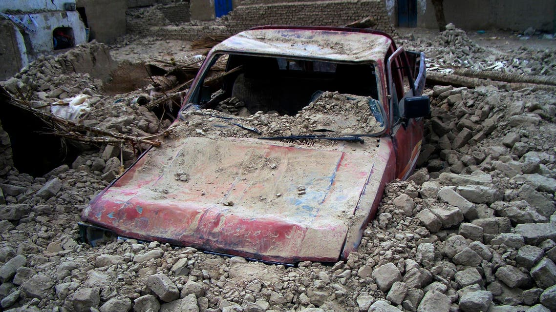 A destroyed car is seen in the rubble after an earthquake in the town of Mashkeel, southwestern Pakistani province of Baluchistan, near the Iranian border April 17, 2013. (Reuters)