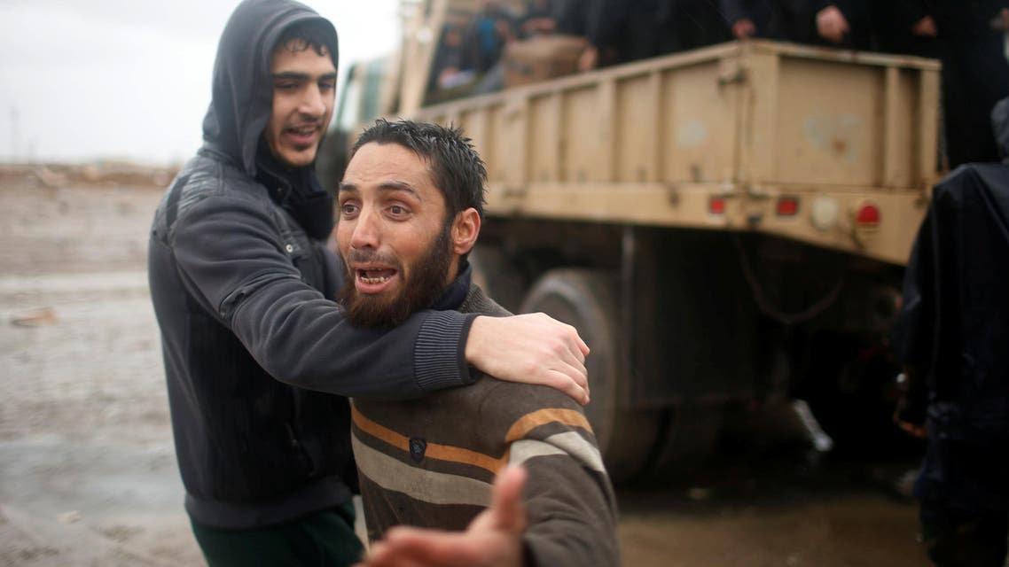 Displaced Iraqis react as they flee their homes on a rainy day, as Iraqi forces battle with Islamic State militants, in western Mosul, Iraq March 16, 2017. (Reuters)