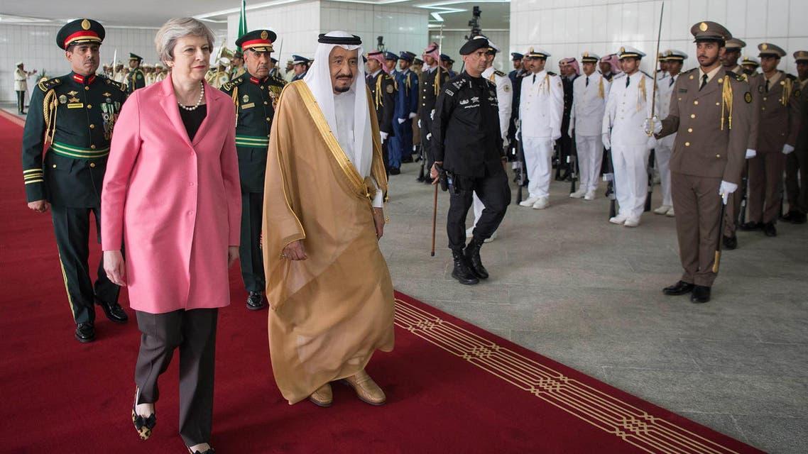 Saudi Arabia's King Salman bin Abdulaziz Al Saud and British Prime Minister Theresa May review the honour guard during a reception ceremony in Riyadh, Saudi Arabia, April 5, 2017. AP