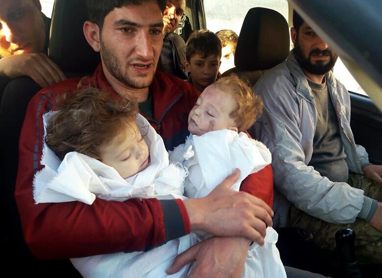 Abdul-Hamid Alyousef holds his twin babies who were killed during a suspected chemical weapons attack, in Khan Sheikhoun in Idlib. (AP)